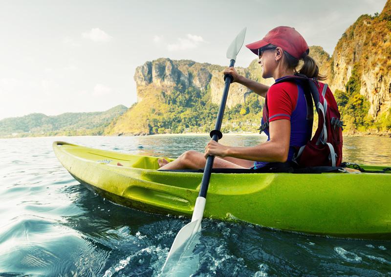kayak through blue water on an adventure