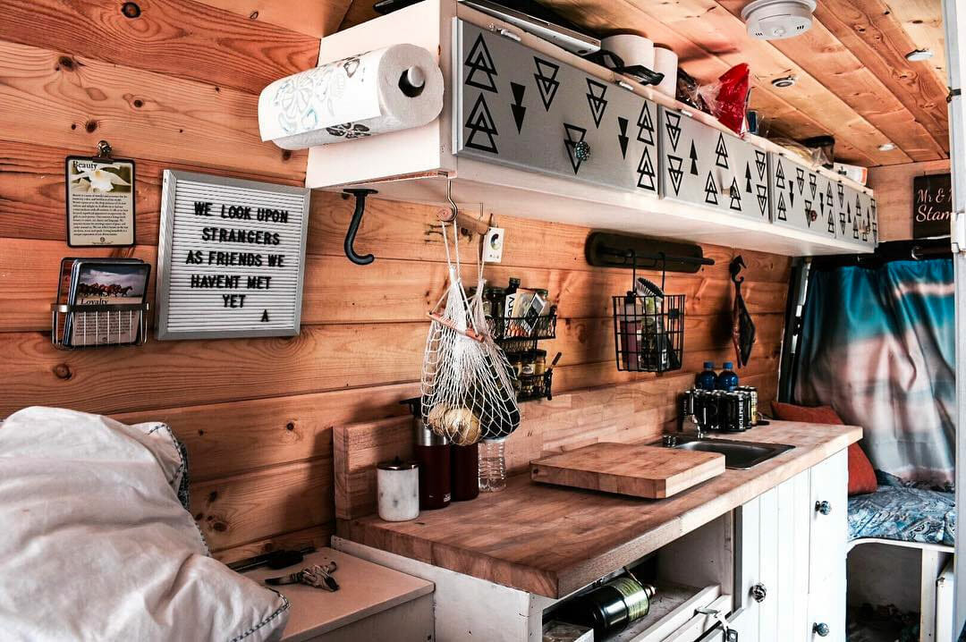 Van build kitchen storage in a diy custom campervan interior