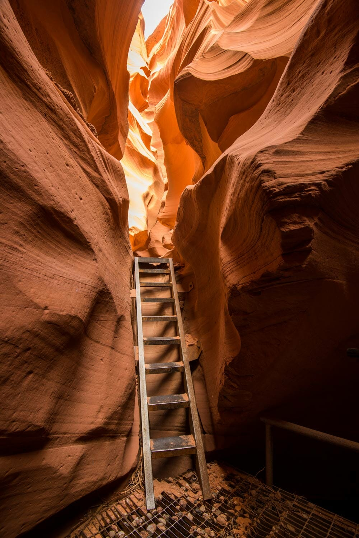 climbing ladders in lower antelope canyon arizona