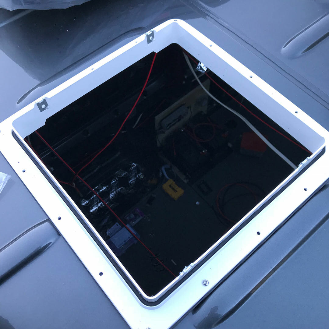 installing a 12V roof vent fan on a campervan conversion